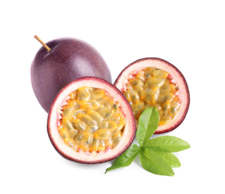 Cut and whole passion fruits with leaf isolated on white