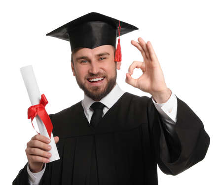 Happy student with graduation hat and diploma on white background