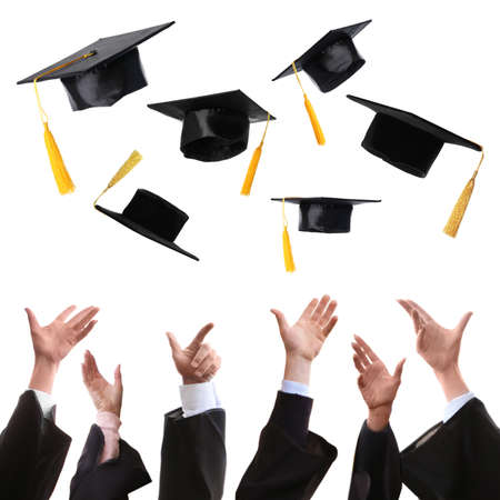 Group of graduates throwing hats against white background, closeup