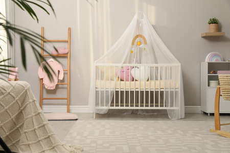 Cozy baby room with crib and other furniture. Interior design