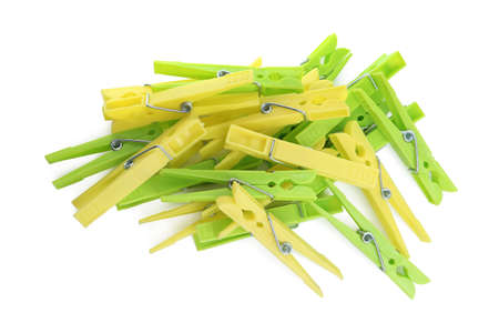 Colorful plastic clothespins on white background, top view Standard-Bild
