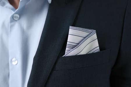 Man with handkerchief in suit pocket, closeup