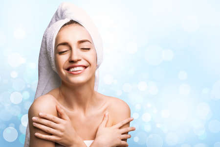 Beautiful young woman with silky skin on light background, space for text. Spa treatment Imagens