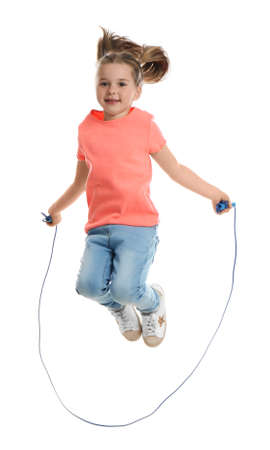 Cute little girl with jump rope on white background Banque d'images