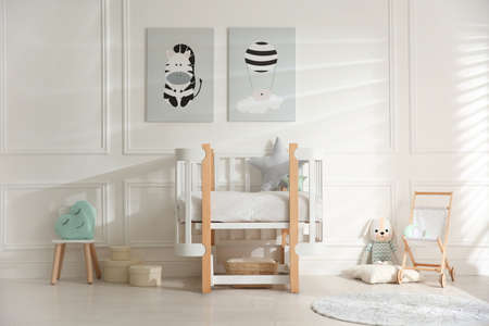 Baby room interior with stylish furniture and toys Banco de Imagens