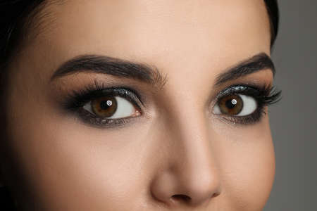 Young woman with evening makeup, closeup. Eye shadow product