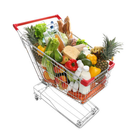 Shopping cart with groceries on white background Stock fotó