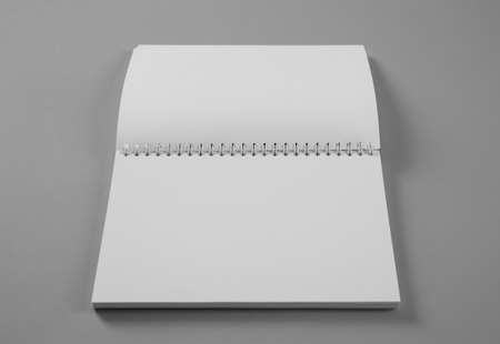 Open blank notebook on grey background. Mockup for design