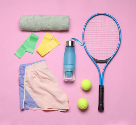 Flat lay composition with sports equipment on pink background