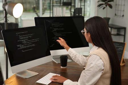 Programmer working at desk in modern office