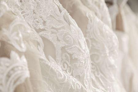 Beautiful wedding dress with lace, closeup view
