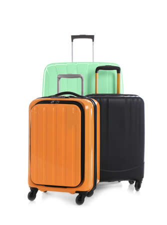 Modern suitcases for travelling on white background