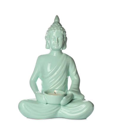 Beautiful ceramic Buddha sculpture with burning candle isolated on white