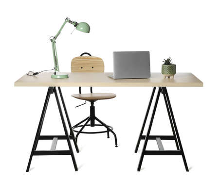 Stylish workplace with wooden desk and comfortable chair on white background