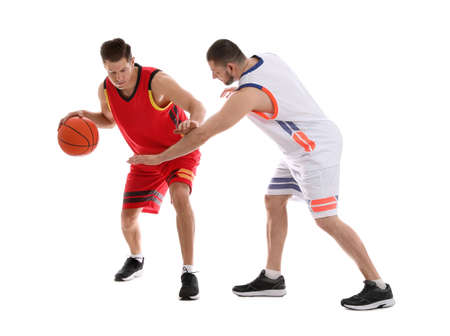 Professional sportsmen playing basketball on white background
