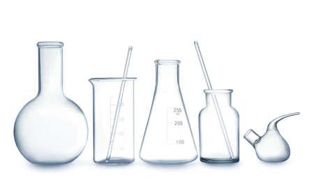 Empty clean laboratory glassware on white background