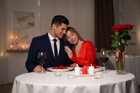 Lovely couple having romantic dinner in restaurant Фото со стока