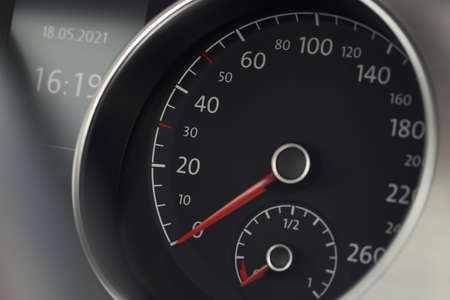 Speedometer on modern car dashboard, closeup view Imagens