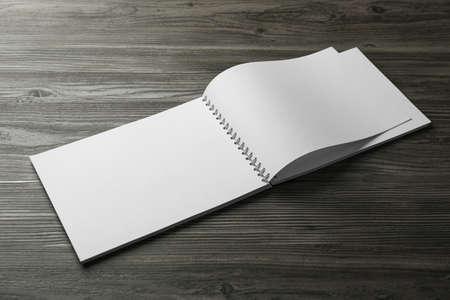 Blank paper brochure on wooden table. Mockup for design