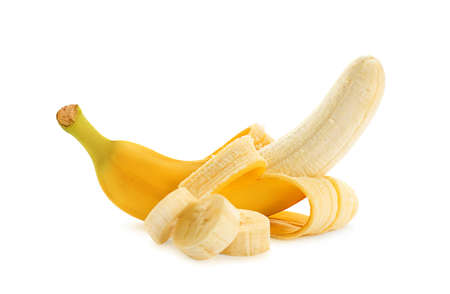 Delicious ripe banana and pieces on white background