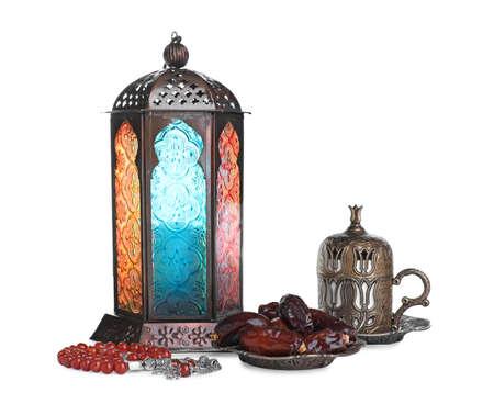 Decorative Arabic lantern, misbaha, dates and coffee on white background
