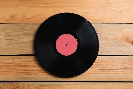 Vintage vinyl record on wooden background, top view 版權商用圖片