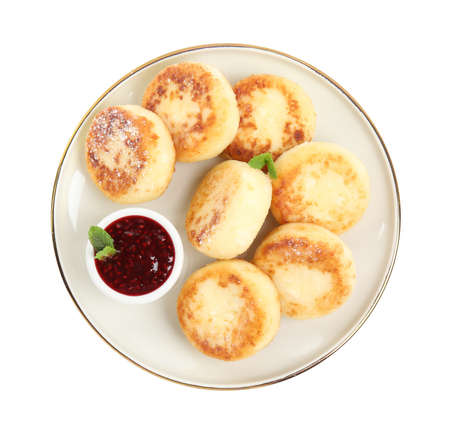Delicious cottage cheese pancakes with jam and icing sugar isolated on white, top view 版權商用圖片