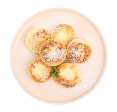 Delicious cottage cheese pancakes with mint and icing sugar isolated on white, top view