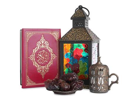 Decorative Arabic lantern, Quran, dates and coffee on white background 版權商用圖片