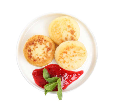 Delicious cottage cheese pancakes with jam and mint isolated on white, top view 版權商用圖片