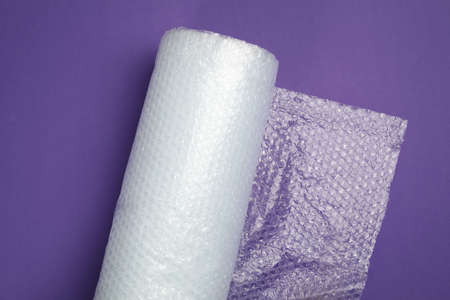 wrap roll on purple background, top view