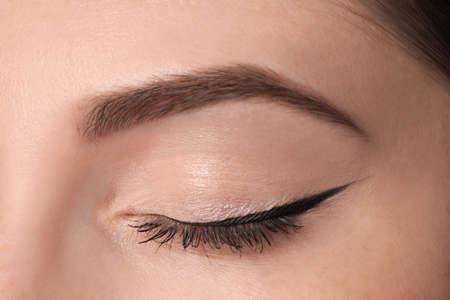 Beautiful woman with black eyeliner, closeup view