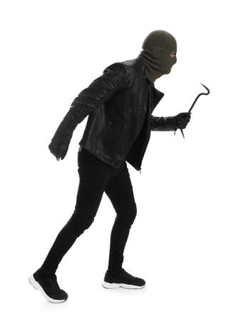 Man wearing knitted balaclava with crowbar on white background