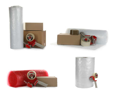 Set with bubble rolls, cardboard boxes and tape dispensers on white background