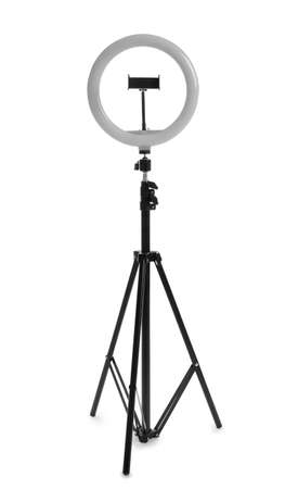Modern tripod with ring light isolated on white