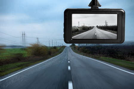 Modern dashboard camera mounted in car, view of road during driving Standard-Bild