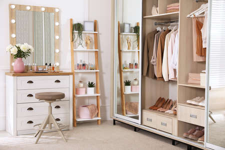 Elegant room with dressing table and wardrobe. Interior design