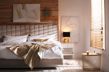 Comfortable bed with stylish white linens indoors