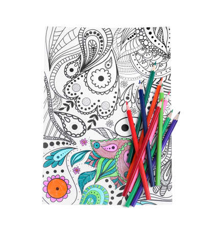 Antistress coloring page and pencils on white background, top view