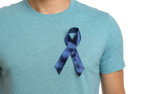 Man with blue ribbon on white background, closeup. Urology cancer awareness