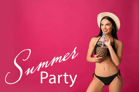 Summer party. Beautiful young woman in black bikini with cocktail on pink background