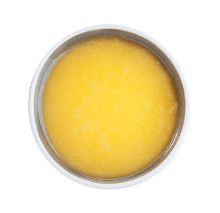 Bowl of Ghee butter isolated on white, top view