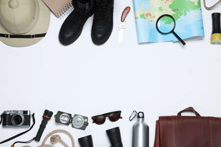 Flat lay composition with different safari accessories on white background. Space for text