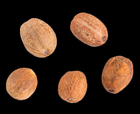 Five delisious nutmeg isolated in black background Stock Photo
