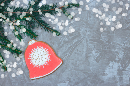 Greeting card with decorative gingerbread, spruce branch and gift boxes on a gray cement background. Overhead of christmas new year background. View from above. Copy space Stock Photo