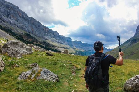 man with a selfie stik taking photos in Ordesa y Monte Perdido National Park Banque d'images