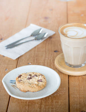 Chocolate chip cookies with coffee in a glass cup