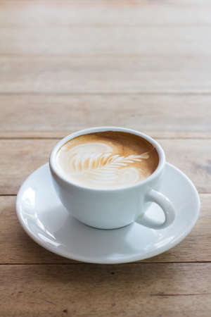 Coffee in a cup on a wooden table