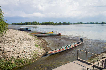 Longtail boat parking at the river bank in Songkhla, Thailand