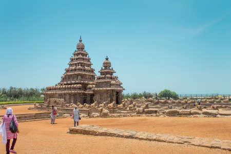 Tourists walking to the Shore temple at Mahabalipuram, Tamil Nadu, India.